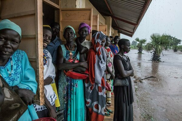 South Sudanese women taking shelter from flooding