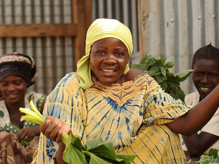 femme vendant des légumes